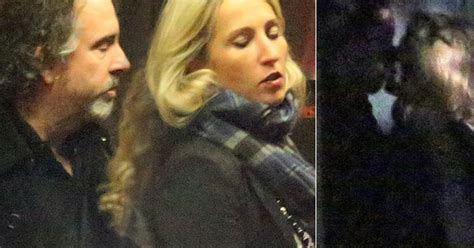 """Tim Burton pictured """"embracing mystery blonde"""" in London"""